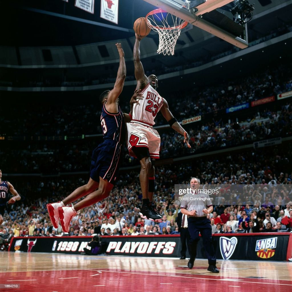 Michael Jordan of the Chicago Bulls goes for a dunk against the New Jersey Nets during Game One round one of the 1998 NBA Playoffs at the United...