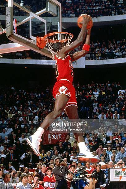 Michael Jordan of the Chicago Bulls goes for a dunk during the Slam Dunk Competition part of the 1988 NBA AllStar Weekend at Chicago Stadium in...
