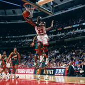 Michael Jordan of the Chicago Bulls goes for a layup against the Seattle Supersonics circa 1996 during the NBA game at Chicago Stadium in Chicago...