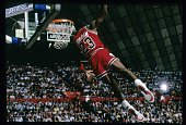 Michael Jordan of the Chicago Bulls goes for the slam dunk during a circa 1987 NBA basketball game Jordan played for the Bulss from 198493 and 1995 98