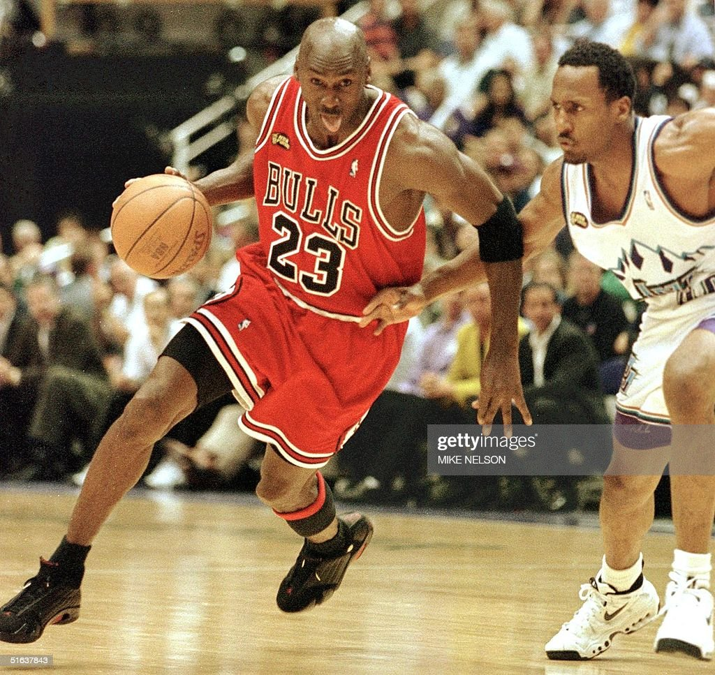 <a gi-track='captionPersonalityLinkClicked' href=/galleries/search?phrase=Michael+Jordan+-+Basketball+Player&family=editorial&specificpeople=73625 ng-click='$event.stopPropagation()'>Michael Jordan</a> (L) of the Chicago Bulls goes to the basket past Shandon Anderson of the Utah Jazz 14 June during game six of the NBA Finals at the Delta Center in Salt Lake City, UT. The Bulls lead the best-of-seven series 3-2. AFP PHOTO/Mike NELSON