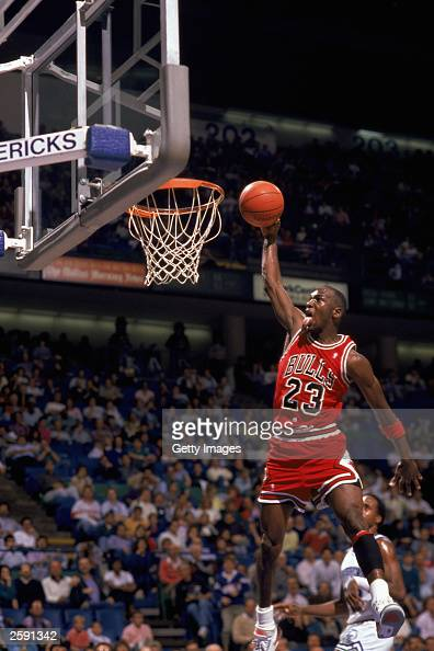 Michael Jordan of the Chicago Bulls goes up for a dunk during an NBA game against the Dallas Mavericks at Reunion Arena in Dallas Texas