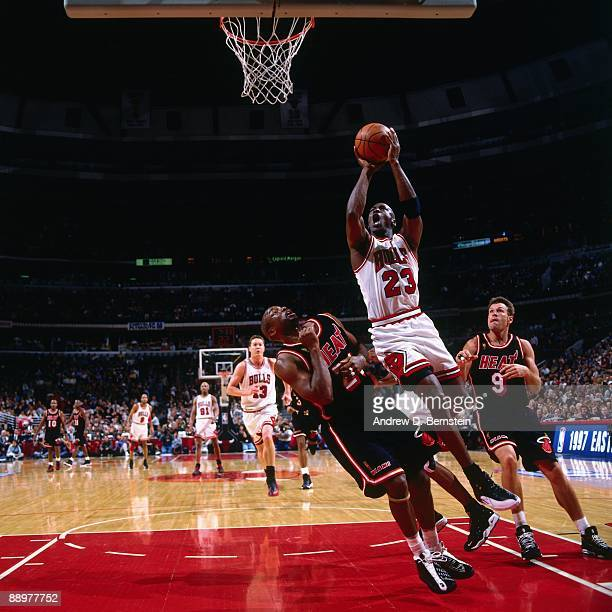 Michael Jordan of the Chicago Bulls goes up for a shot against Voshon Lenard of the Miami Heat in Game Two of the Eastern Conference Finals during...