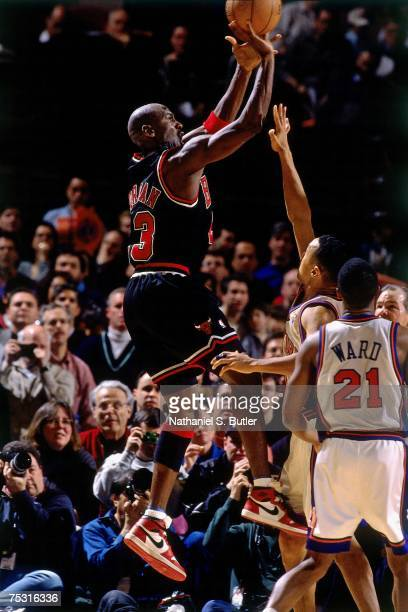 Michael Jordan of the Chicago Bulls goes up for a shot wearing his original Nike sneakers against the New York Knicks during his final game at...