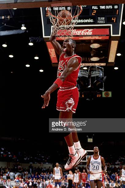 Michael Jordan of the Chicago Bulls goes up for a slam dunk against the Los Angeles Clippers during an NBA game at the Forum in 1987 in Los Angeles...