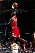 Michael Jordan of the Chicago Bulls goes up for a slam dunk against the Seattle Sonics during Game Five of the 1996 NBA Finals at Key Arena on June...