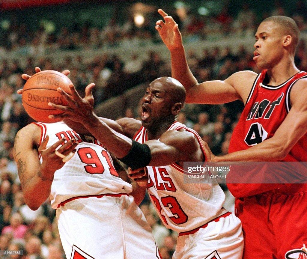 Michael Jordan C of the Chicago Bulls grabs a re