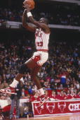 Michael Jordan of the Chicago Bulls jumps to shoot a basket at the Chicago Center in Chicago Illinois