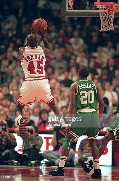 Michael Jordan of the Chicago Bulls jumps to shoot the ball during the game against the Boston Celtics at the United Center on March 30 1995 in...