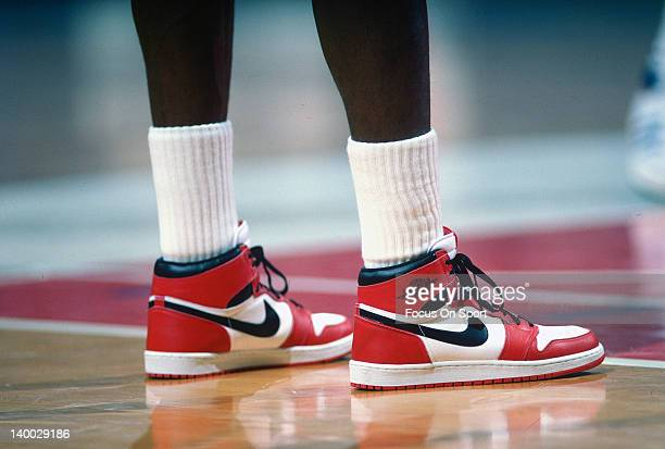 Michael Jordan of the Chicago Bulls looks on against the Washington Bullets during an NBA basketball game circa 1985 at the Capital Centre in...