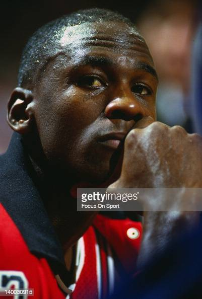 Michael Jordan of the Chicago Bulls looks on from the bench against the Washington Bullets during an NBA basketball game circa 1986 at the Capital...