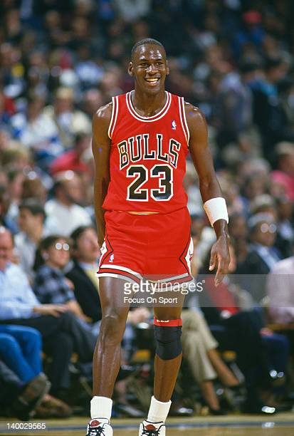 Michael Jordan of the Chicago Bulls looks on smiling against the Washington Bullets during an NBA basketball game circa 1986 at the Capital Centre in...