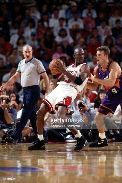 Michael Jordan of the Chicago Bulls looks to make a play against the Phoenix Suns during Game Five of the 1993 NBA Championship Finals at Chicago...