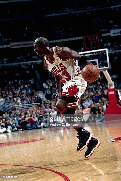 Michael Jordan of the Chicago Bulls makes a move before driving to the basket against the Seattle Sonics during Game Two of the 1996 NBA Finals at...