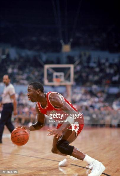 Michael Jordan of the Chicago Bulls moves the ball at the parameter against the Los Angeles Clippers during a 198485 season game at the Sports Arena...
