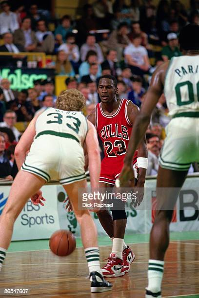 Michael Jordan of the Chicago Bulls moves the ball up court against Larry Bird of the Boston Celtics in Game One of the Eastern Conference...