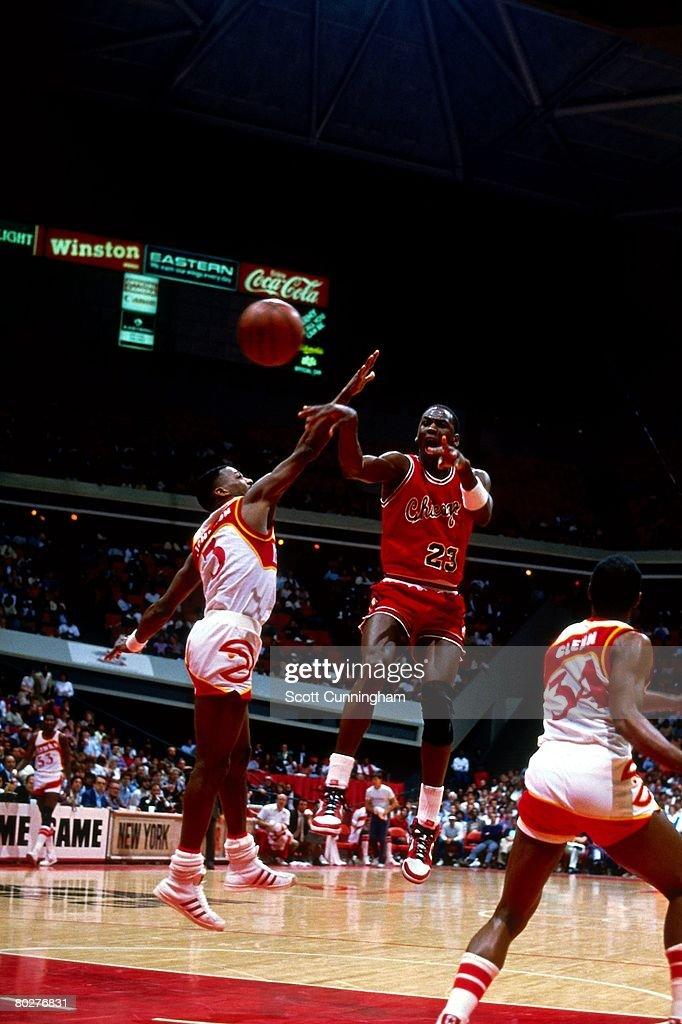 Michael Jordan of the Chicago Bulls passes against the Atlanta Hawks during his rookie season of 1984 at the Omni in Atlanta Georgia NOTE TO USER...