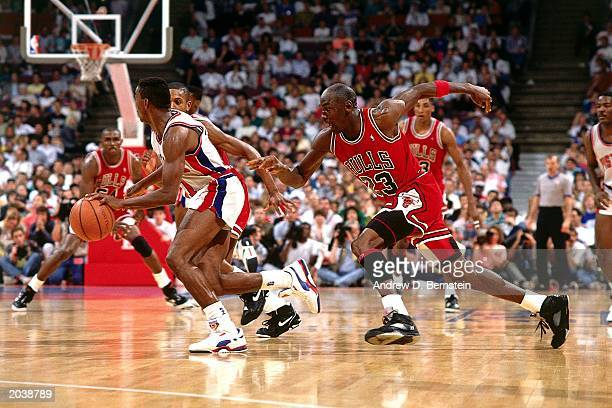 Michael Jordan of the Chicago Bulls persues Isiah Thomas of the Detroit Pistons during the 1989 season NBA game at The Palace Of Auburn Hills in...