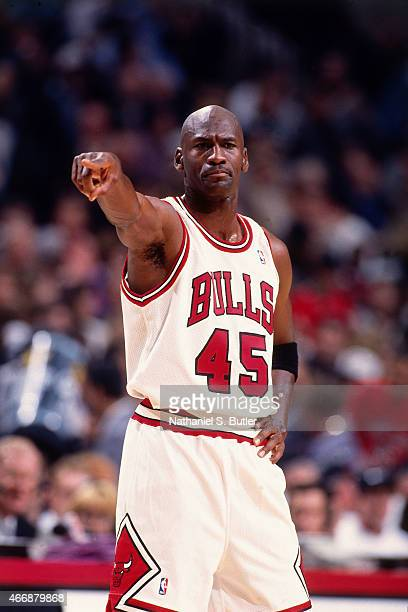 Michael Jordan of the Chicago Bulls points against the Orlando Magic on March 24 1995 at United Center in Chicago Illinois This game is Michael...