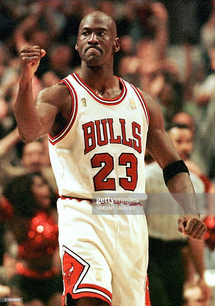 <a gi-track='captionPersonalityLinkClicked' href=/galleries/search?phrase=Michael+Jordan+-+Basketball+Player&family=editorial&specificpeople=73625 ng-click='$event.stopPropagation()'>Michael Jordan</a> of the Chicago Bulls pumps his fist after scoring the game winning basket in the fourth quarter 01 June during game one of the NBA Finals at the United Center in Chicago, IL. The Bulls defeated the Utah Jazz 84-82.