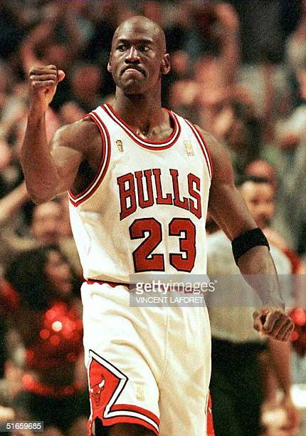 Michael Jordan of the Chicago Bulls pumps his fist after scoring the game winning basket in the fourth quarter 01 June during game one of the NBA...