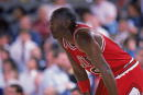 Michael Jordan of the Chicago Bulls rests on the court during a game NOTE TO USER User expressly acknowledges and agrees that by downloading and/or...
