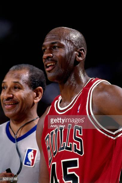 Michael Jordan of the Chicago Bulls shares a light moment with a referee during an NBA game on March 28 1995 NOTE TO USER User expressly acknowledges...