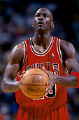 Michael Jordan of the Chicago Bulls shoots a free throw during a game in 1998 at United Center in Chicago Illinois NOTE TO USER User expressly...