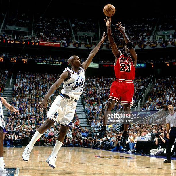 Michael Jordan of the Chicago Bulls shoots a jump shot against Bryon Russell the Utah Jazz in Game Six of the 1998 NBA Finals against the Chicago...