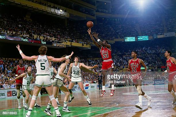 Michael Jordan of the Chicago Bulls shoots a jump shot against Danny Ainge of the Boston Celtics during an NBA game played in 1986 at the Boston...