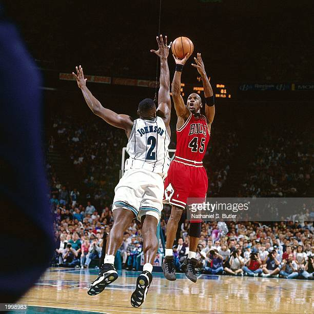Michael Jordan of the Chicago Bulls shoots a jump shot against Larry Johnson of the Charlotte Hornets in Game two of the Eastern Conference...