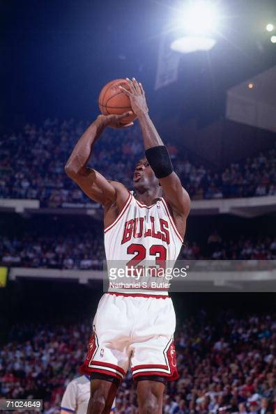 Michael Jordan of the Chicago Bulls shoots a jump shot against the Cleveland Cavaliers during Game One of the Eastern Conference Finals during the...