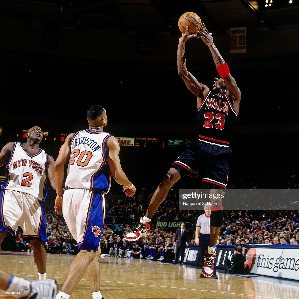 Michael Jordan of the Chicago Bulls shoots a jump shot wearing his original Nike sneakers against the New York Knicks during his final game at...