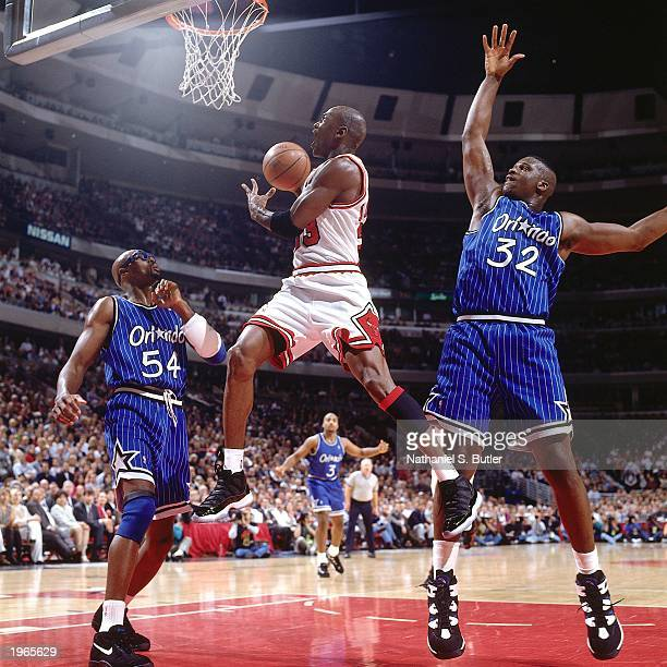 Michael Jordan of the Chicago Bulls shoots a layup against the Orlando Magic in Game two of the Eastern Conference Finals during the 1996 NBA...