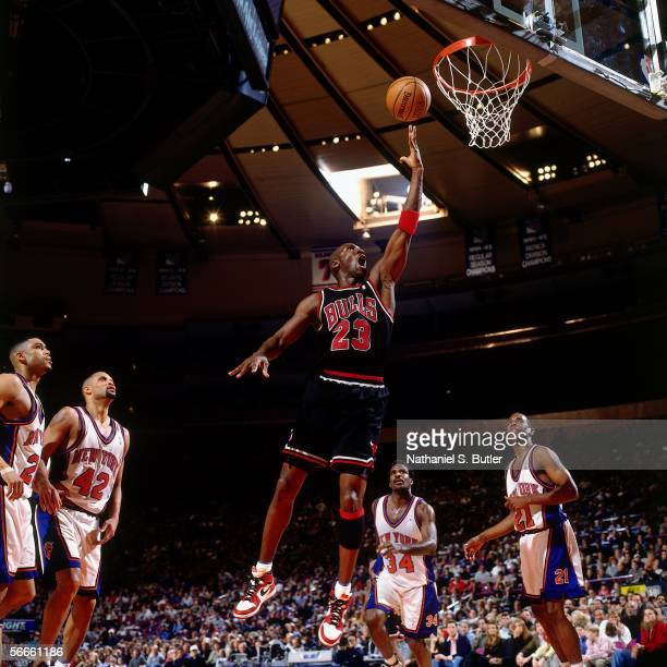 Michael Jordan of the Chicago Bulls shoots a layup against the New York Knicks circa 1998 at Madison Square Garden in New York New York NOTE TO USER...