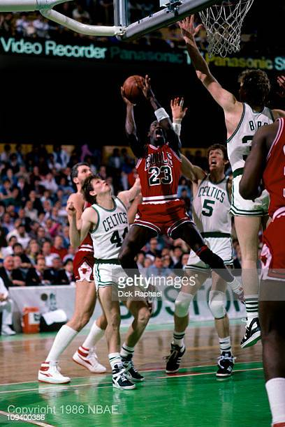 Michael Jordan of the Chicago Bulls shoots against Danny Ainge of the Boston Celtics during Game 2 of the Eastern Conference quarterfinals during the...
