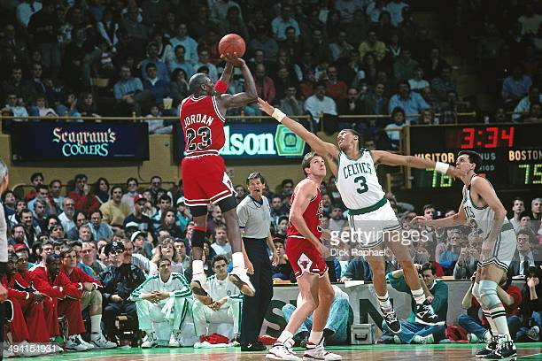 Michael Jordan of the Chicago Bulls shoots against Dennis Johnson of the Boston Celtics during a game played circa 1990 at the Boston Garden in...