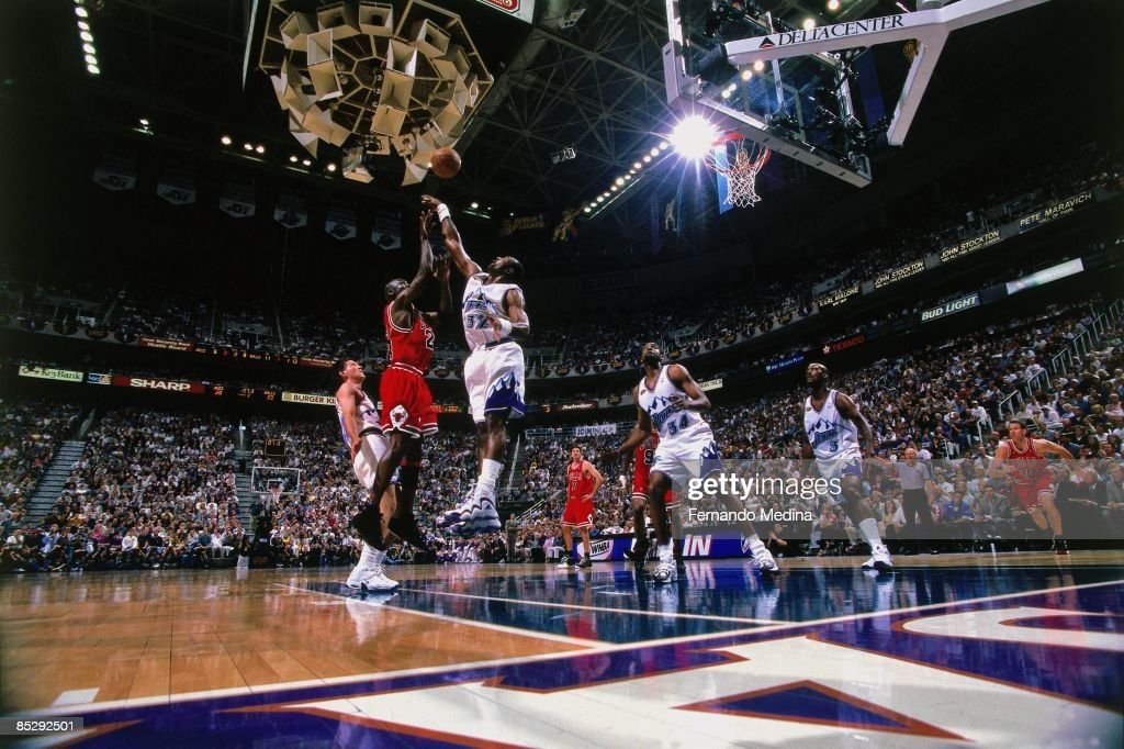 Michael Jordan of the Chicago Bulls shoots over Karl Malone of the Utah Jazz during Game Six of the 1998 NBA Finals played on June 14 1998 at the...