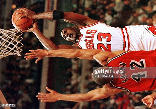 Michael Jordan of the Chicago Bulls shoots over PJ Brown of the Miami Heat 28 May during the first half of game five of the NBA Eastern Conference...