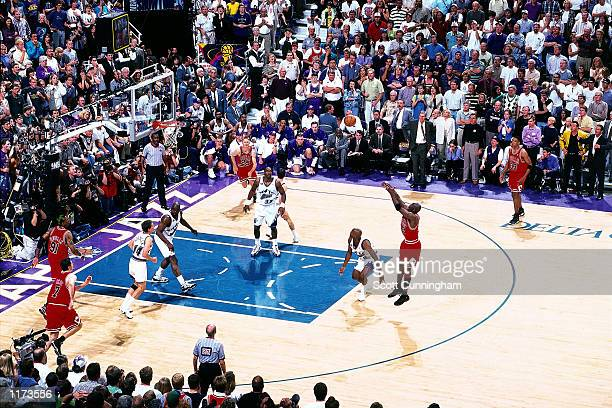Michael Jordan of the Chicago Bulls shoots the game winner against the Utah Jazz in the 1998 NBA FINALS of Game 6 The shot gave the Bulls their sixth...
