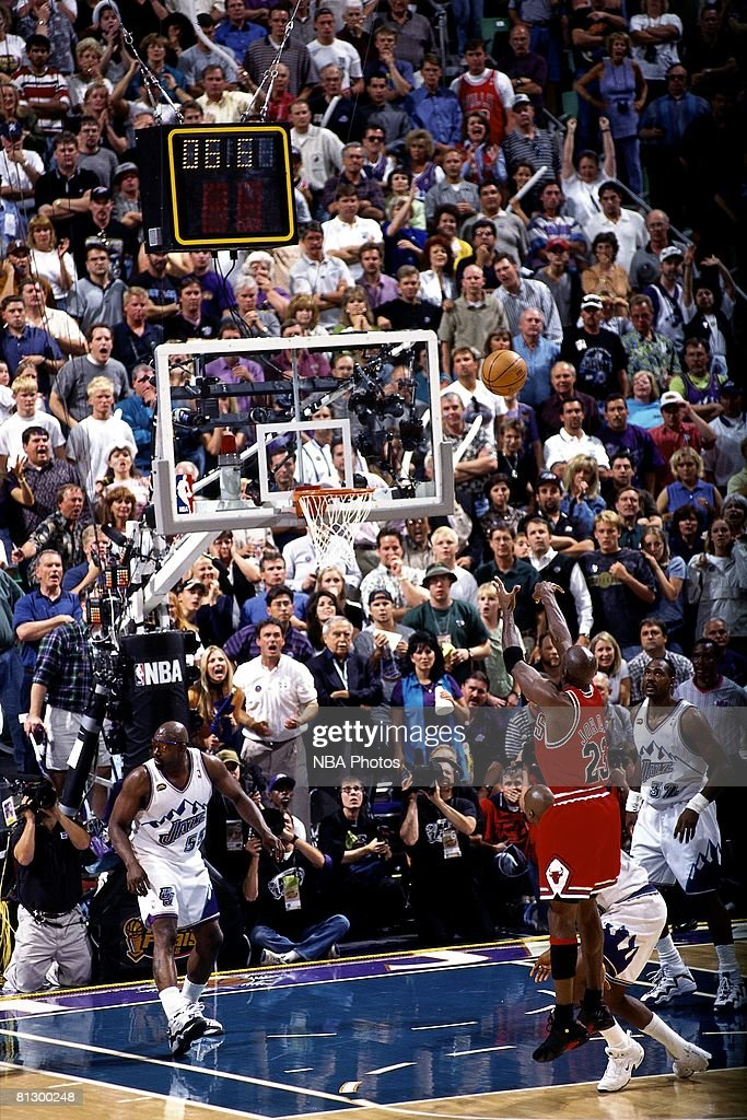 Michael Jordan of the Chicago Bulls shoots the game winning jumpshot against the Utah Jazz during game six of the 1998 NBA Finals played on June 14...