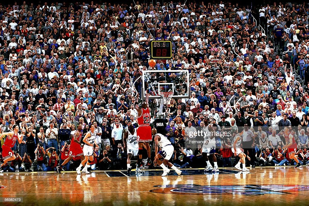 Michael Jordan of the Chicago Bulls shoots the gamewinning jumpshot over Byron Russell of the Utah Jazz during Game Six of the 1998 NBA Finals on...