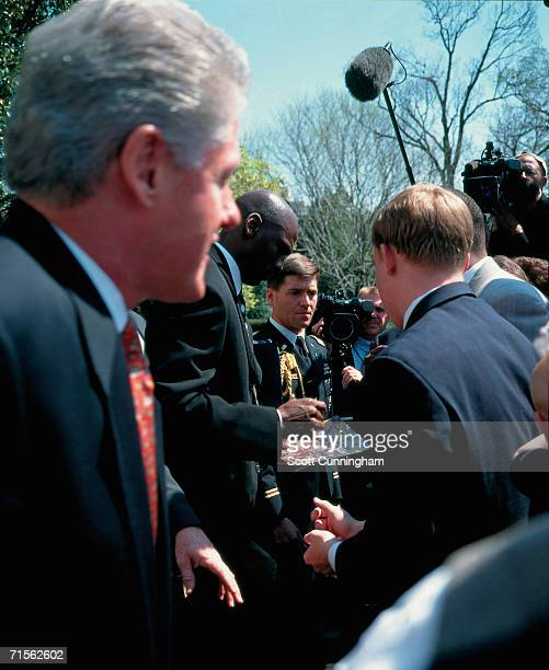 Michael Jordan of the Chicago Bulls signs an autograph during the team's visit to the White House on April 3 1997 in Washington DC NOTE TO USER User...
