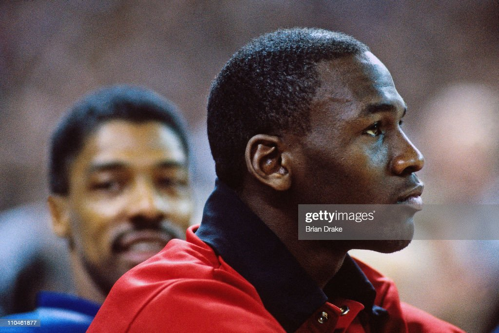 Michael Jordan #23 of the Chicago Bulls sits on the bench against the Portland Trail Blazers during a game played at Memorial Coliseum in 1987 in Portland, Oregon.