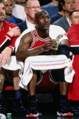 Michael Jordan of the Chicago Bulls sits on the bench wrapped in towels during Game Five of the 1997 NBA Finals played against the Utah Jazz on June...