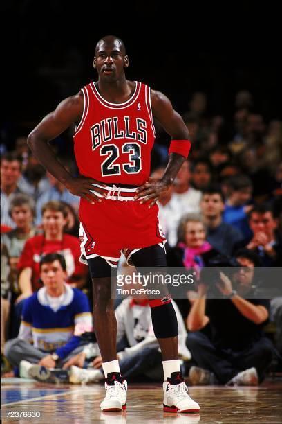 Michael Jordan of the Chicago Bulls stands on the court Mandatory Credit Tim DeFrisco /Allsport