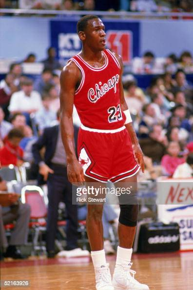 Michael Jordan of the Chicago Bulls stands on the court moves the ball at the parameter against the Los Angeles Clippers at the Sports Arena in Los...