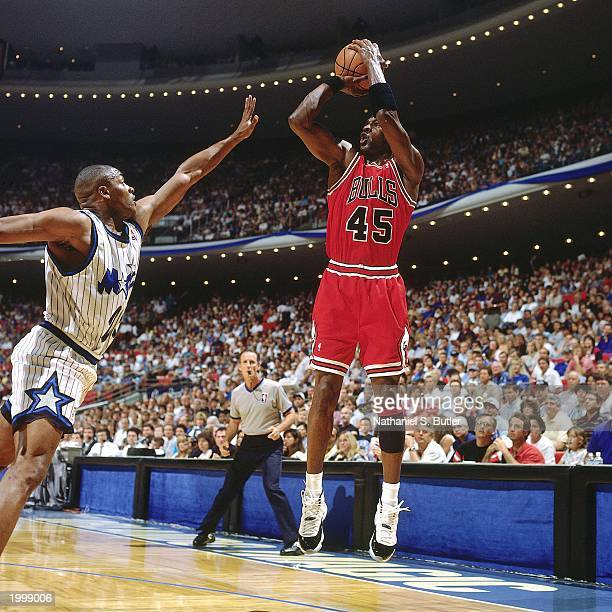 Michael Jordan of the Chicago Bulls takes a jump shot against Nick Anderson of the Orlando Magic in Game one of the Eastern Conference Semifinals...