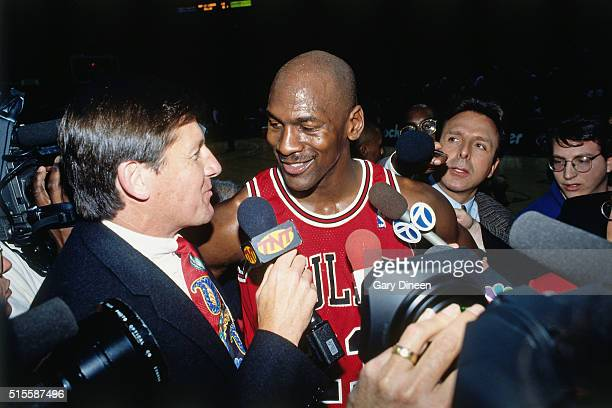 Michael Jordan of the Chicago Bulls talks with Craig Sager of TNT Sports against the Milwaukee Bucks on April 16 1996 at the Bradley Center in...
