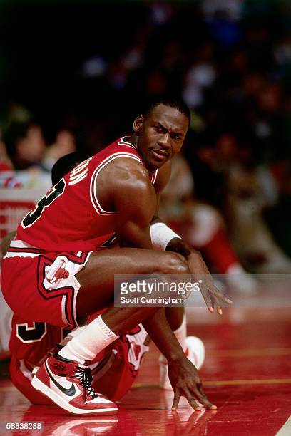 Michael Jordan of the Chicago Bulls waits to get back into the game against the Atlanta Hawks during an NBA game at the Omni circa 1987 in Atlanta...